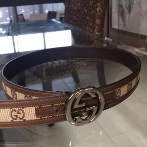 Brown Gucci belt with logo G's